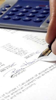 Pen, paper, and calculator for a tax audit IRS
